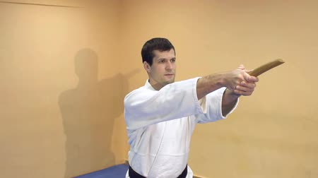 quimono : Young man practicing Aikido in the gym. Aikido demonstration.