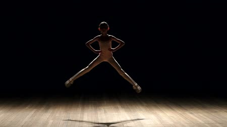 balerína : Little girl dancer dancing and jumping on stage in the dark. Silhouette. Smoke. The concert lighting. Ballet.