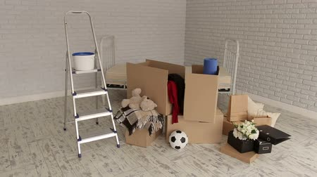 belongings : View of the new apartment, boxes and stairs. Housewarming. The concept of housewarming and new home.