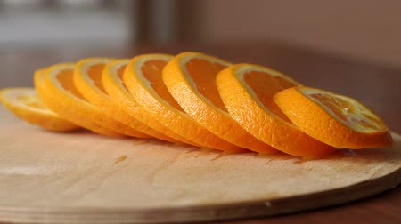 mandarinka : Close-up of juicy ripe sliced orange on a wooden table. Healthy diet. Citrus. Copy space.