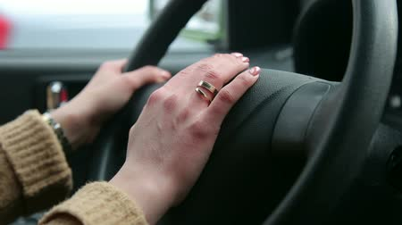 odometer : Close-up of female hands on steering wheel while driving a car in winter. The girl with the manicure keeps hands on the steering wheel of the car. Stock Footage