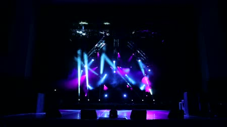 discoteca : Stage lights with smoke on concert. Background in show. Stage lights and smoke. Colored lights on an empty concert stage with smoke.