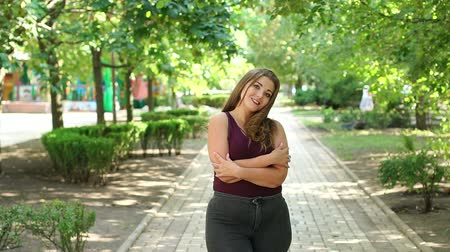 xxl : Portrait of a cute teenage girl with excess weight in the city Park in the summer. Plus size model. Girl XXL.