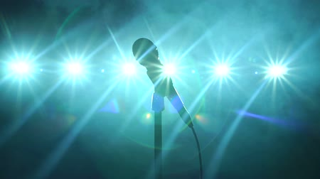 gravador : Close-up of microphone on stage in the dark on a black smoky background and bright spotlights. Slow motion. Stock Footage