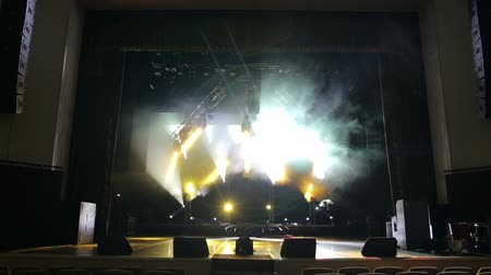 pop art background : Multi-colored stage lights, light show at the concert. Light and smoke show on the stage.