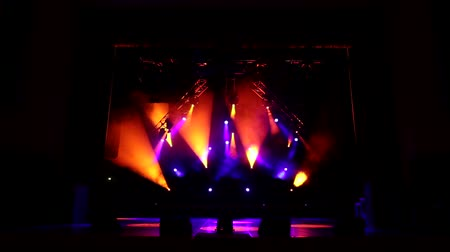 music band stage : Colorful light flashing and white rays on an empty stage in the dark. Stage lighting. Light show. Stock Footage