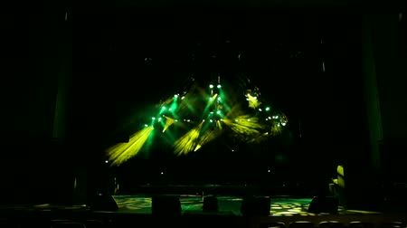 korhadt : Yellow and green stage lights. Scene, stage light with spotlights and smoke. Colorful Stage lights at concert. Stage lights and smoke.