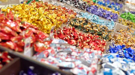 вкусности : Large choice of sweets in a candy shop. Close-up of lots of candy in colorful wrappers in a pastry shop. Supermarket.