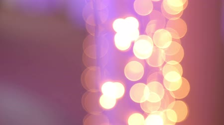 festoon : Christmas garland with Golden and purple lights, close-up. Blurred Christmas lights. Bokeh. Stock Footage