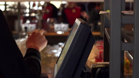 registrace : Close-up of the waiters hand on the touch screen in the cafe, registration and payment of the order. Hand of the waiter near the working touch screen monitor.