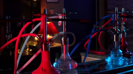 mouthpiece : Close-up of hookahs with multicolored pipes in the restaurant. Shisha smoking concept. Modern hookah. Many glass hookahs close-up.