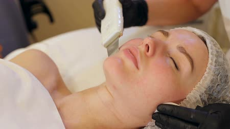 microdermabrasion : Ultrasonic face cleaning, peeling, in a beauty salon. Woman receiving cleansing therapy with a professional ultrasonic equipment in cosmetology office.