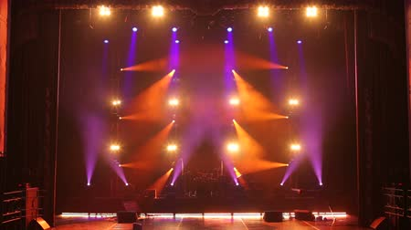 rock festival : Stage lights with smoke on concert. Background in show. Stage lights and smoke. Colored lights on an empty concert stage with smoke.