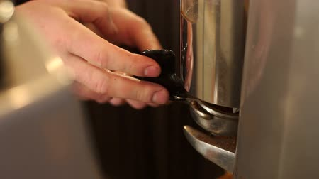 portafilter : Close-up of barista holding portafilter and putting ground coffee, he grinding coffee beans in coffee grinder. Slow motion. Modern coffee shop. Slow motion. Stock Footage