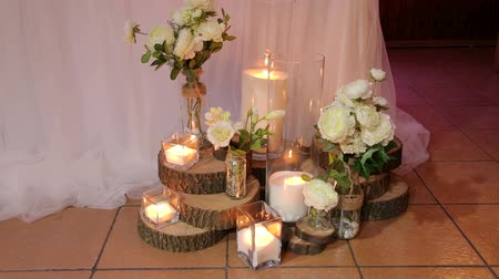 boho : Wedding decor, candles in glass flasks standing on the floor. Decoration with candles and flowers wedding arch.