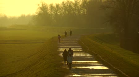 plash : People walking on top of the river dam. Stock Footage