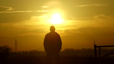 Man looking at sunset.