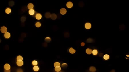 Orange light particles blinking and moving up and down. Stock Footage