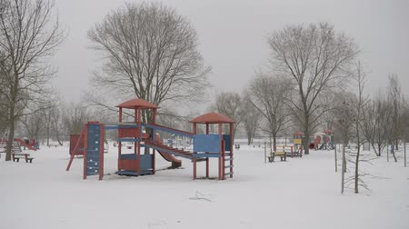 Kids playground in snow wide shot Stock Footage