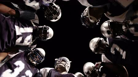sportowiec : Low angle view looking up into the inside of a huddle Wideo