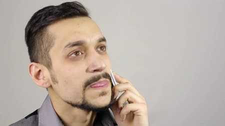 mexicano : young bearded man talking on the phone