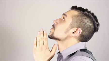 православие : Young bearded man praying, asking God for help.