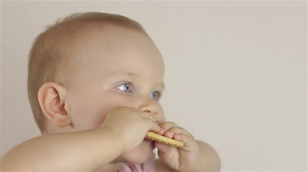 nibble : Little baby girl eating cookies Stock Footage