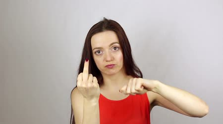 Wicked aggressive woman shows middle finger