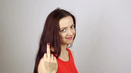transação : Wicked aggressive woman shows middle finger