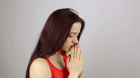 sinner : A young beautiful woman prays, asking God for help. Stock Footage
