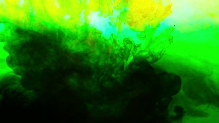 Abstract green ink in water on background Stock Footage