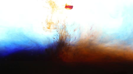 abstract red and blue ink in water on white background Stock Footage