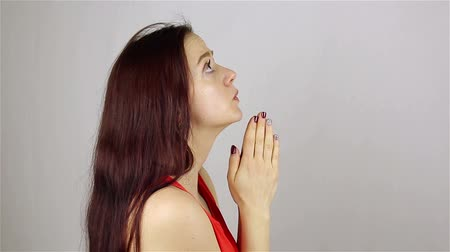 segítség : A young beautiful woman prays, asking God for help. Stock mozgókép
