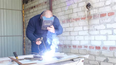 welding helmet : Welder Working in the garage Stock Footage