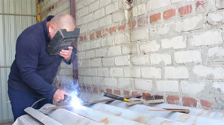 Welder Working in the garage Stock Footage