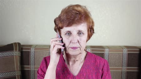 Elderly woman speaks by phone