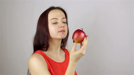 eat background : Beautiful young woman eating a red apple