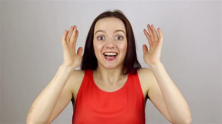 astonishment : Beautiful woman gets shock on white background