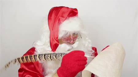 papyrus : Santa is writting a list of gifts Stock Footage