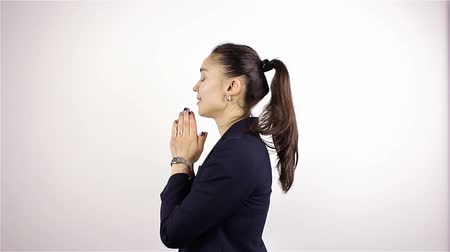 megváltás : A young beautiful woman prays, asking God for help. Stock mozgókép