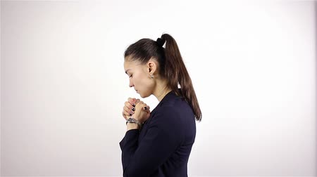 believer : A young beautiful woman prays, asking God for help. Stock Footage