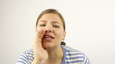 mouthpiece : Young beautiful woman makes a loud statement, gesture Stock Footage
