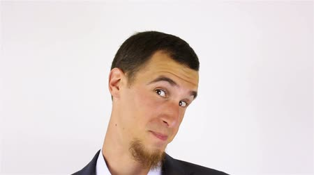 professionalism : young bearded man expression shows emotions in front of the camera. fool around