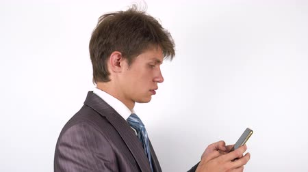 sending : young man hands writing sms, texting on smartphone. Stock Footage