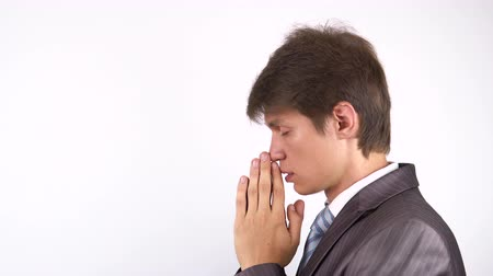 sinner : Young bearded man praying, asking God for help.