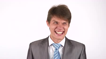 professionalism : young man expression shows emotions in front of the camera. fool around