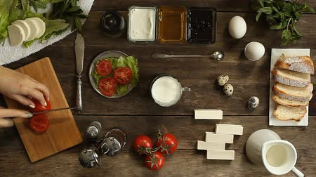 item : cooking salad on a wooden surface. close-up