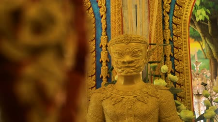 budha : Golden buddha statue in meditation pose with window on the background