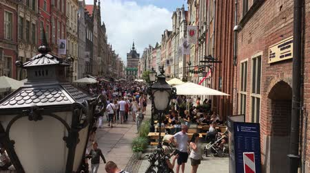 Old town of Gdansk with pedestrians at the Long Market in front of the Golden Gate - Poland.