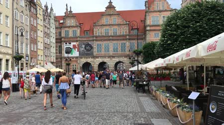 Old town of Gdansk with pedestrians at the Long Market in front of the Green Gate - Poland.